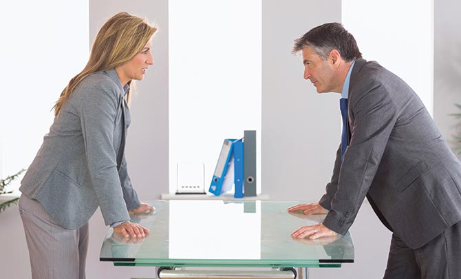 Business man & woman having a serious dicussion